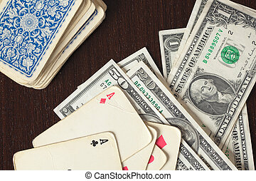 vintage poker cards and american money on table