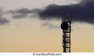 Communication tower - Silhouette of communication tower with...