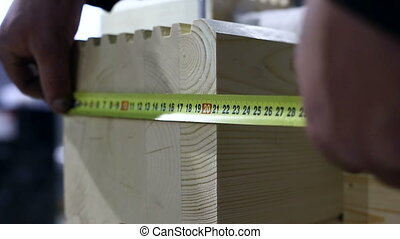 View on worker measures width of profiled bar, close-up