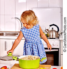 Child cooking at kitchen. - Child is trying prepare...