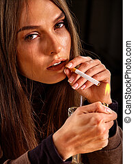Woman smokes cigarette. - Look bad young woman smokes...
