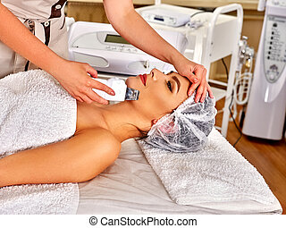 Woman receiving electric facial peeling massage - Woman in...