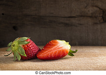 ripe strawberries on wood table, rustic simple style