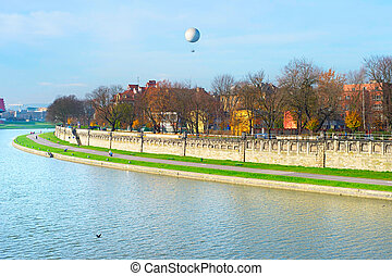 Vistula quayside in Krakow, Poland - Sunny embankment of...