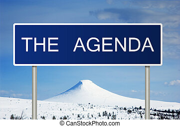Road sign with text The Agenda - A blue road sign with white...