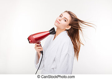 Beautiful sensual young woman in bathrobe drying hair with...