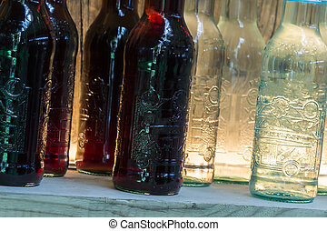 Black and White Drink Bottles on Wooden Shelf, Alcoholic...