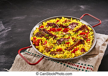 Spanish speciality paella al homo with spare ribs and black...