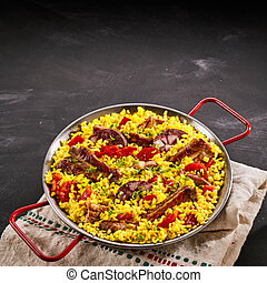 Paella al homo with black pudding and spare ribs seasoned...