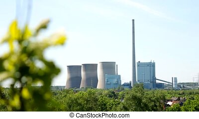 A Power plant with sky and plants - Kraftwerk