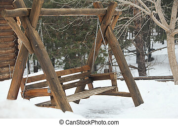 wooden swing in the forest winter - Photo wooden swing in...