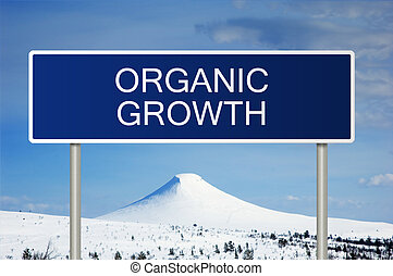 Road sign with text organic growth