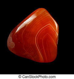 Red chalcedony carnelian, isolated on black background