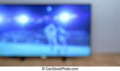 Man watching smart tv in living room Shot from behind