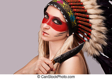 Girl red Indian. - Beautiful girl in a military headdress.