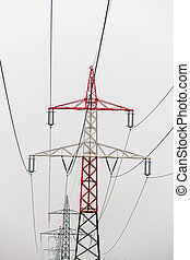 electricity pylons - masts of a high voltage line for power...
