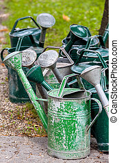 watering cans on a cemetery, death, memorial and grave...