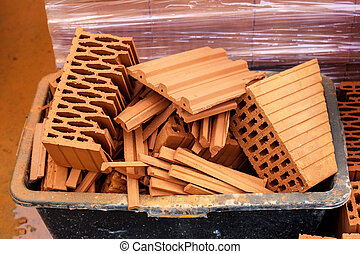 on the site - building materials and tools stand around at a...