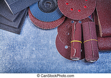 Assortment of abrasive materials on metallic background.