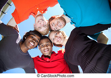 Faces of smiling Multi-racial college students - A group of...