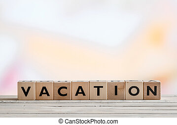 Vacation message made of wooden cubes on a table
