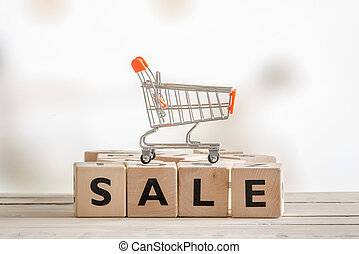 Sale sign with a shopping cart - Sale sign with a metallic...