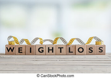 Weightloss sign with measure tape