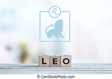Leo star sign on a table - Leo star sign on a wooden table