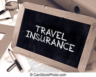 Travel Insurance Handwritten on Chalkboard Composition with...
