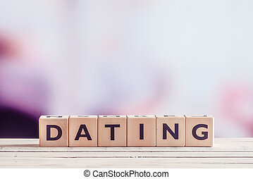 Dating sign in wood on a table on violet background