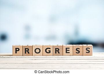 Progress word spelled with wooden cubes