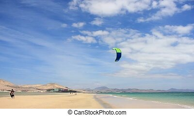 Kitesurfer walk on a beach with Softkite on Fuerteventura...