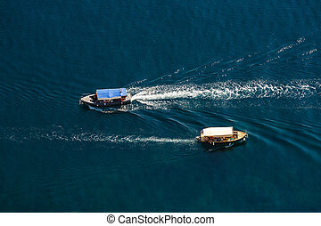 View from the top down by two passenger ship passing by,...