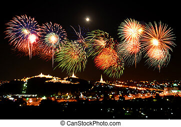 Colorful fireworks celebration and the city night light...