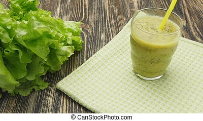 Healthy green smoothie with kiwi, apple and - Healthy green...