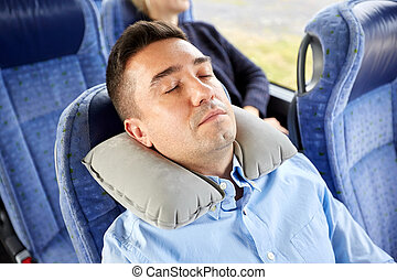 man sleeping in travel bus with cervical pillow - transport,...