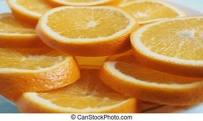 sliced oranges on a plate. shooting travel