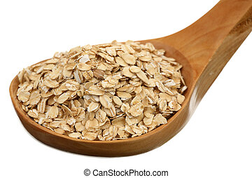 Rolled oats in a wooden spoon on a white background