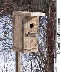 Birdhouse from unplaned boards. Spring, a house for the...