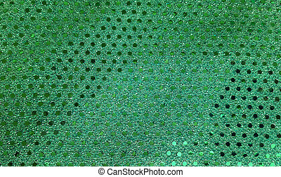 green fabric with sequins - Close up of green textile with...