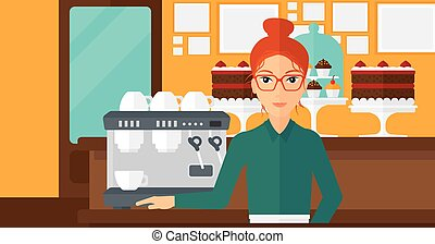 Barista standing near coffee maker. - A woman standing near...