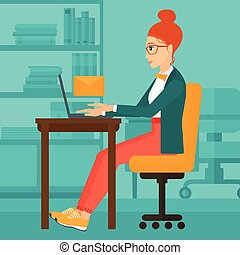 Woman receiving email. - A woman sitting at the table in...