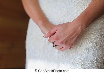 Hands of the bride with a ring - Hands bride stacked...