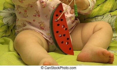 Smart Newborn Playing with a Watermelon Like Toy - Smart...