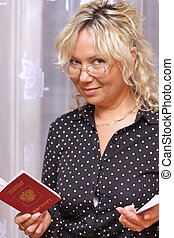 beautiful business woman with a passport in the hands
