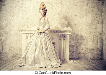ancient style - Elegant young woman in a lush medieval dress...