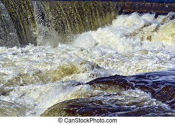 Whitewater Rapids with White Caps - Close up of tumultuous...