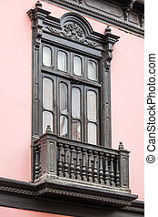 wooden balcony and a window