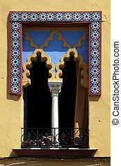 Arabic arched windows and geometric tiles