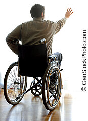 disabled sitting in a wheelchair in the room near the window...